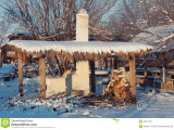 stove_under_canopy_winter_yard_covered_snow_49417247